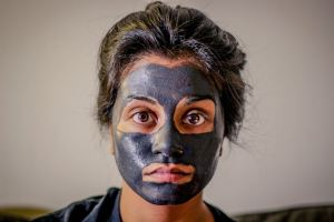 Woman with face mask. Photo by Chris Knight on Unsplash